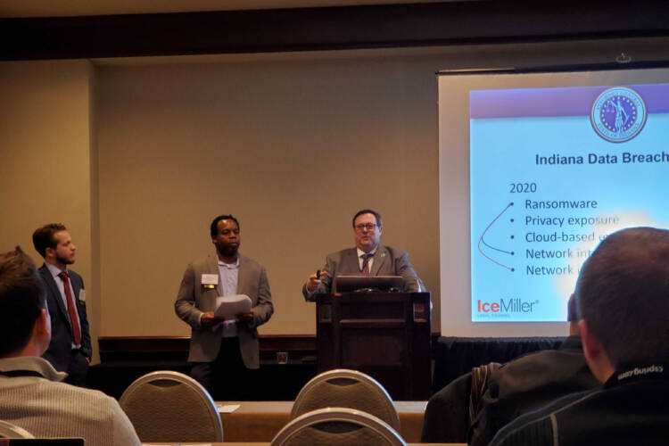(left to right) Ice Miller associate Mason Clark and partner Stephen Reynolds present with Office of Attorney General Section Chief Doug Swetnam at the Indiana Chamber 2020 Business Technology Summit. (Samantha Horton/IPB News)