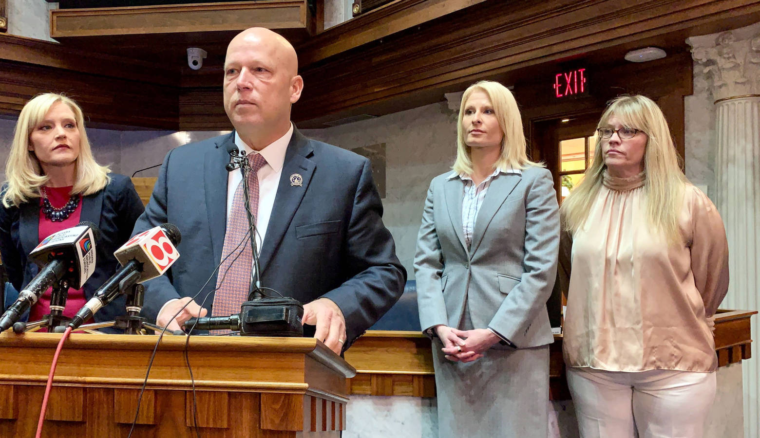 Sen. Mike Crider (R-Greenfield) talks about his legislation with Sen. Erin Houchin (R-Salem), left, and sexual assault prevention advocates supporting him. (Brandon Smith/IPB News)