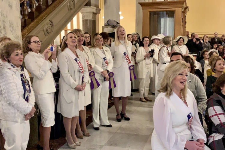 Members of the Indiana General Assembly celebrate the women's suffrage centennial at the Statehouse. (Brandon Smith/IPB News)