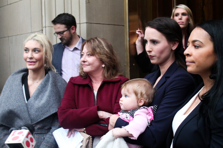 (Left to right) Former gymnasts Sarah Klein, Marcia Frederick, Rachael Denhollander and Tasha Schwikert respond to questions outside the Birch Bayh Federal Building & U.S. Courthouse. (Samantha Horton/IPB News)