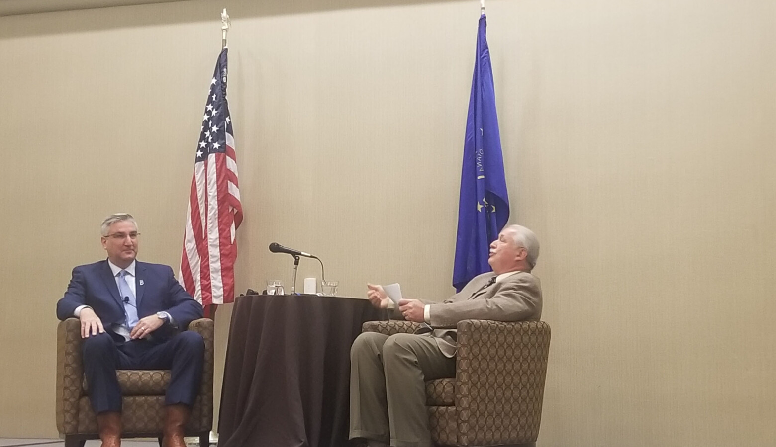 Indiana Farm Bureau President Randy Kron talks with Gov. Eric Holcomb about issues impacting the Hoosier agriculture industry. (Samantha Horton/IPB News)