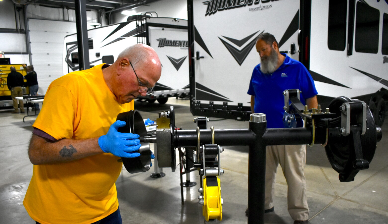 Ralph Decker completes his last practical exam under the supervision of instructor Mike Curl at the RV Technical Institute. (Justin Hicks/IPB News)