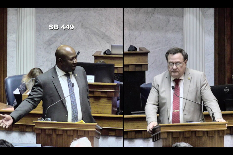 Sen. Greg Taylor (D-Indianapolis), left and Sen. Mike Young (R-Indianapolis) debate the juvenile sentencing bill on the Senate floor. (Courtesy of the Indiana General Assembly)