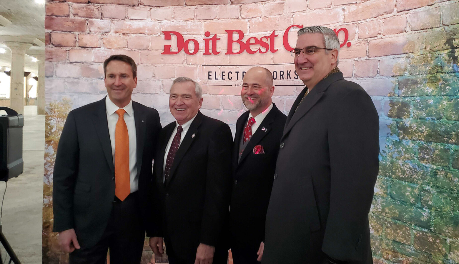 (Left to right) President and CEO Dan Starr, Fort Wayne Mayor Tom Henry, RTM Ventures partner Jeff Kingsbury and Gov. Eric Holcomb pose for a photo following the announcement. (Samantha Horton/IPB News)