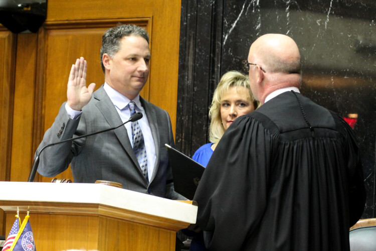 Speaker Todd Huston (R-Fishers) sworn in by Supreme Court Justice Mark Massa. (Lauren Chapman/IPB News)