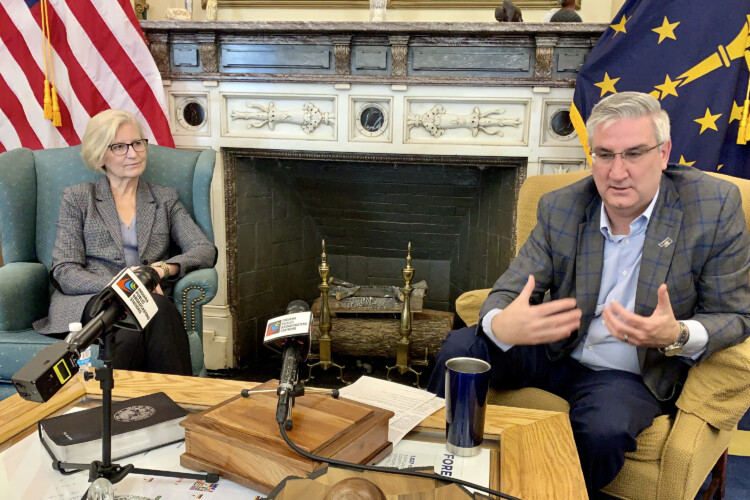 Indiana Health Commissioner Dr. Kris Box, left, and Gov. Eric Holcomb discuss the state's response to COVID-19. (Brandon Smith/IPB News)