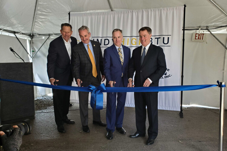 (Left to right) South Side Landfill's Joel Zylstra, EDL North America CEO Jim Grant, Kinetrex Energy President and CEO Aaron Johnson and Indianapolis Mayor Joe Hogsett cut the ribbon on Indiana's largest renewable gas plant. (Samantha Horton/IPB News)