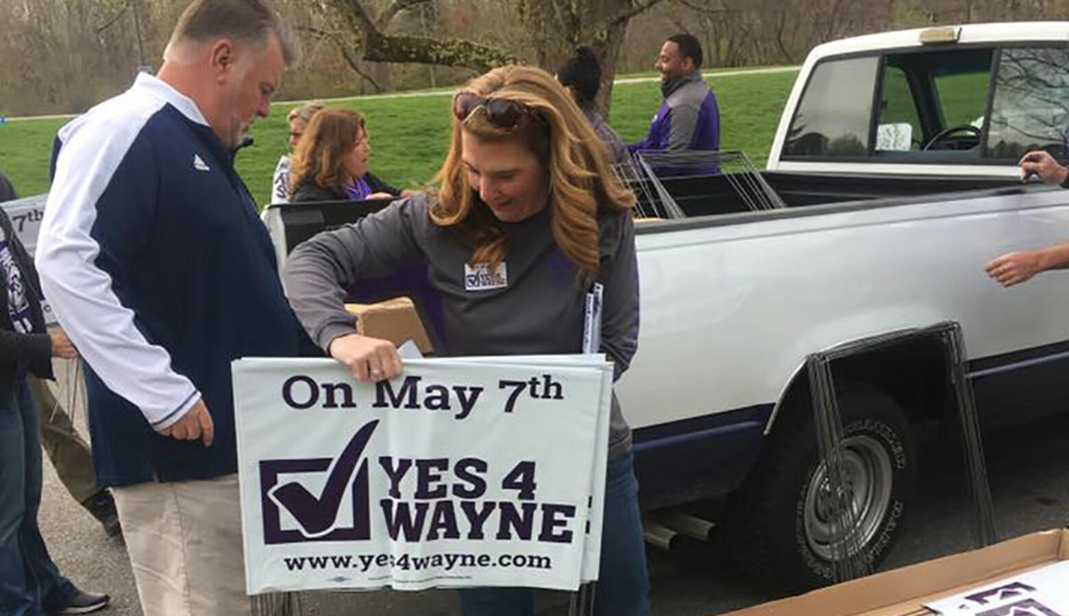 Volunteers distribute signs for Wayne Township Schools ahead of the May 2019 election. (Yes4Wayne/Facebook)