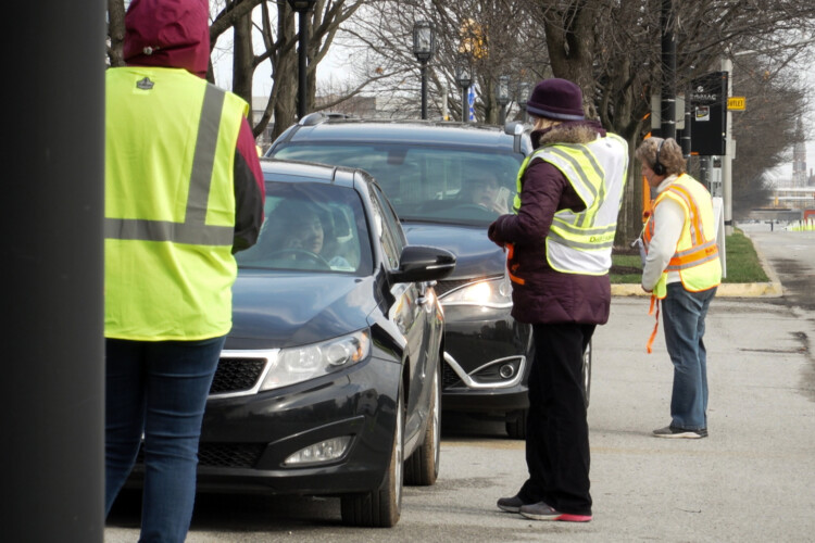 "Eli Lilly has expanded its drive-thru testing for COVID-19 to ""front-line essential"" workers, such as grocery store cashiers. (Alan Mbathi/IPB News)"