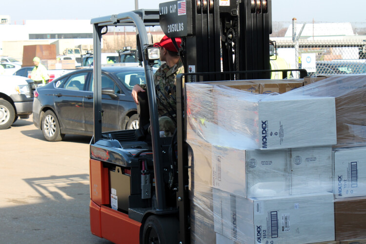 The National Guard organizes deliveries of personal protective equipment to hospitals on March 26. (Lauren Chapman/IPB News)