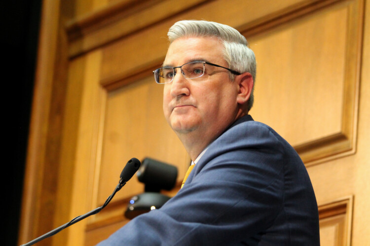 """In a statement, Gov. Eric Holcomb calls the incident a """"lesson learned"""" that even a quick photo requires following experts' guidance to wear a mask in public. (Lauren Chapman/IPB News)"""