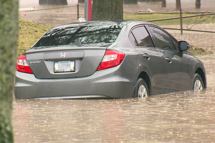 A parked car in high flood waters in Bloomington on Feb. 17, 2019. (FILE PHOTO: Steve Burns/WTIU)