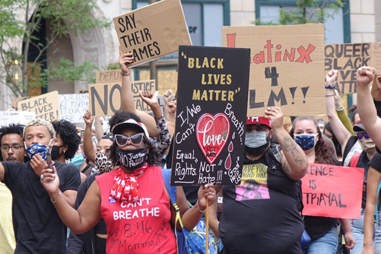 A rally organized by the Indiana Racial Justice Alliance drew several hundred people to Monument Circle on Saturday, June 13, 2020. The group wants the city to reduce the budget of IMPD and reinvest the funds in new community-led initiatives.