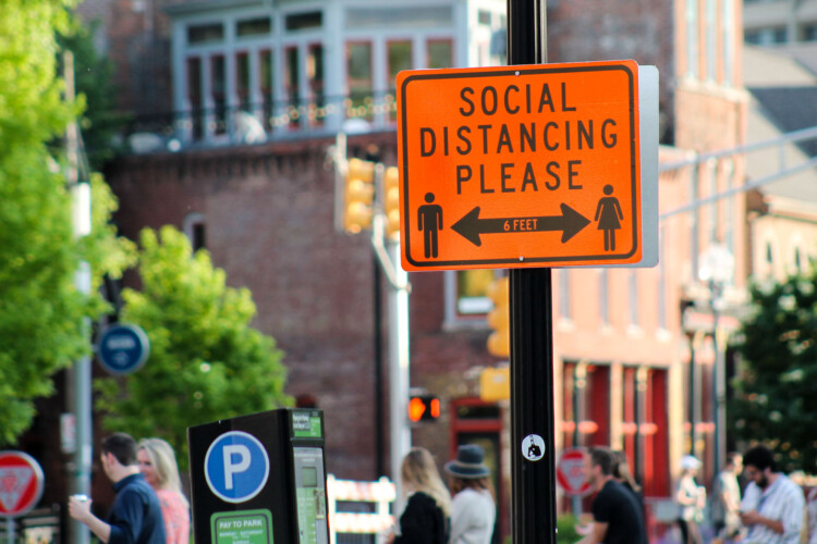 Downtown Indianapolis blocked parts of Mass Ave. to allow outdoor seating. The city also installed signs, reminding people to social distance while visiting businesses and restaurants. (Lauren Chapman/IPB News)