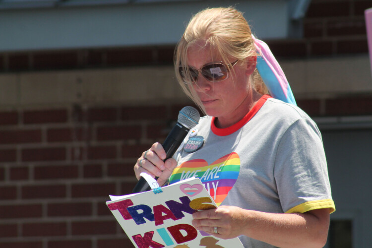 Katie, who didn't provide her last name to protect the identity of her daughter, spoke at the demonstration. Her daughter, who is now a freshman, is not allowed to attend schools run by the Archdiocese. (Lauren Chapman/IPB News)