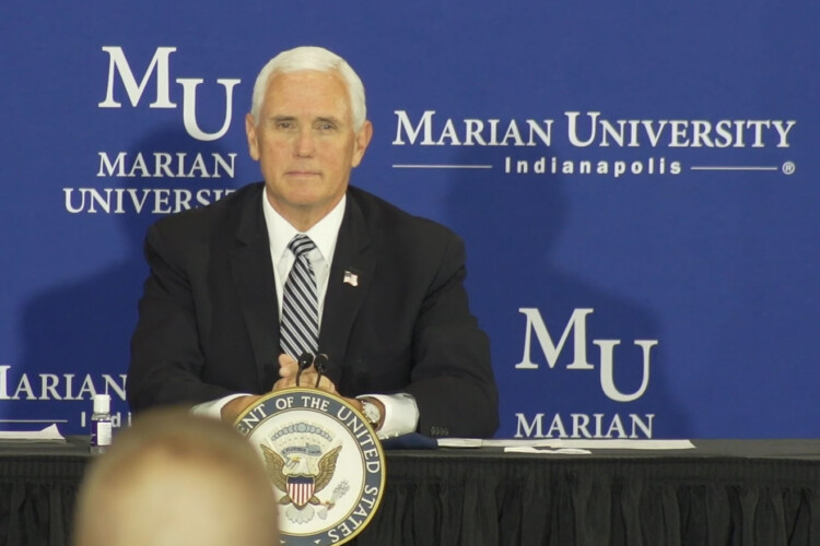 During a roundtable discussion hosted by Marian University in Indianapolis, Pence highlighted the many wraparound services K-12 schools provide. (Alan Mbathi/IPB News)