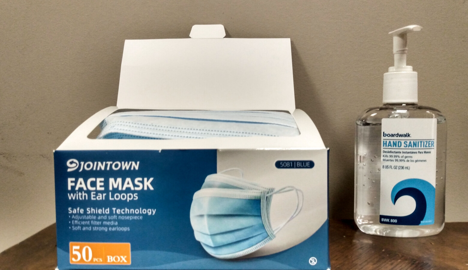 Many businesses are offering hand sanitizer and disposable face masks at their entrances. (Lauren Chapman/IPB News)