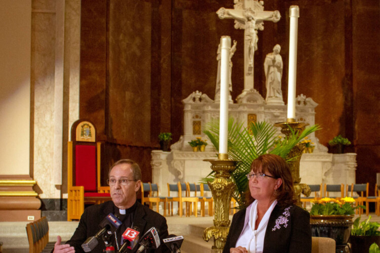 Archbishop Charles Thompson and Superintendent of Catholic Schools Gina Fleming defend the Archdiocese's policy on LGBTQ teachers at Catholics schools last year. (Evan Robbins/WFYI News)