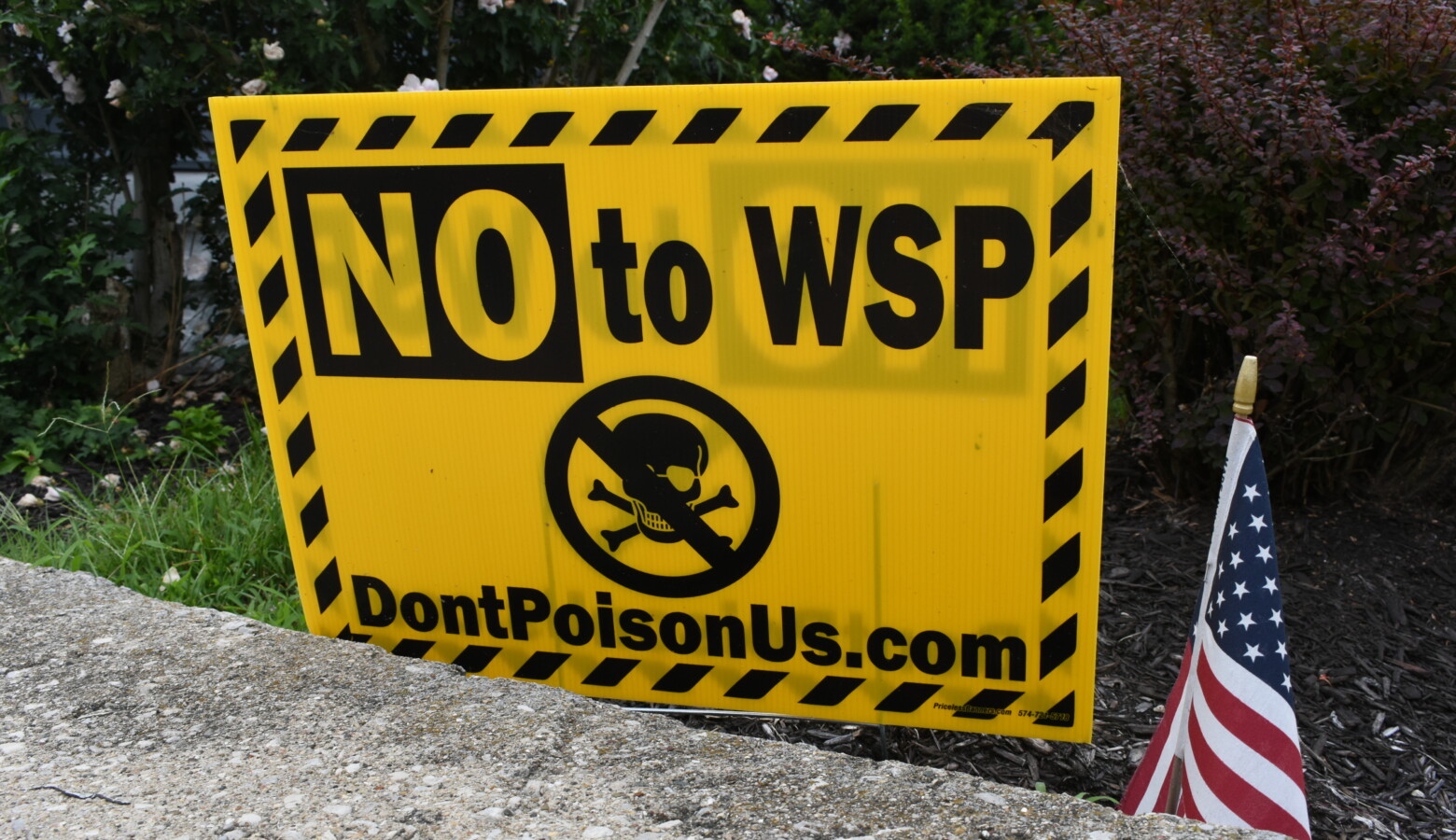 A yard sign in Logansport against the zinc oxide manufacturing plant, owned by Waelz Sustainable Products. (Justin Hicks/IPB News)
