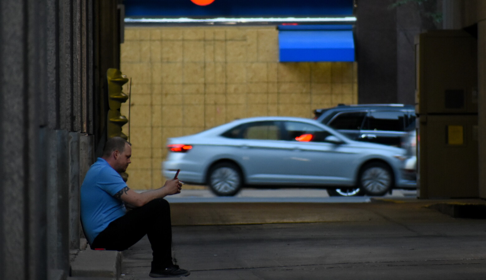 A worker in downtown Indianapolis takes a smoke break. (Justin Hicks/IPB News)