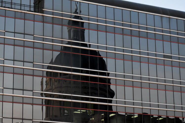 The reflection of the Indiana Statehouse in a nearby building. (Justin Hicks / IPB News)