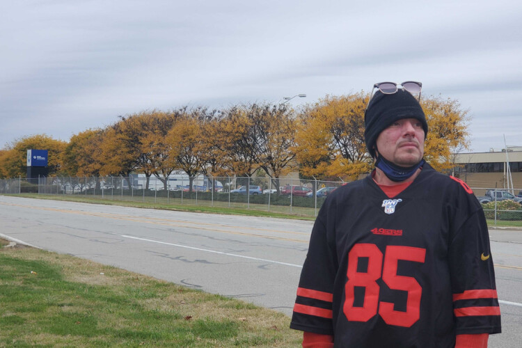 Duane Oreskovic stands across the street from the Indianapolis Carrier plant he worked at for about five years until him and hundreds of others were laid off from the company moving their jobs to Mexico. (Samantha Horton/IPB News)