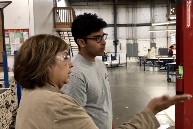 Chris Camacho, a youth apprentice in a similar program in Elkhart County, learns about the operations of the factory on his first day. (Justin Hicks/IPB News)
