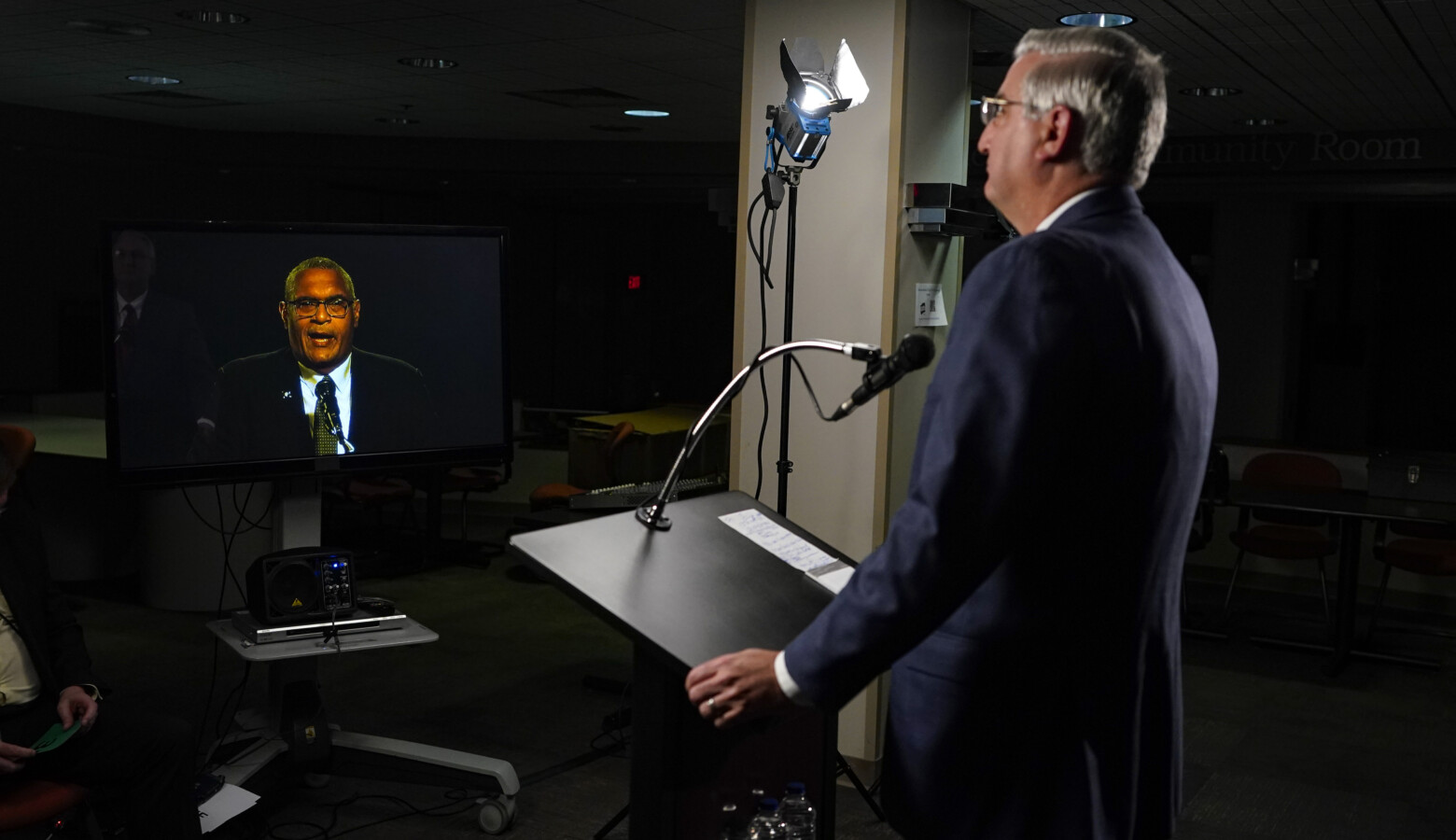 Due to COVID-19 precautions, the three gubernatorial candidates and the moderator were in separate rooms at WFYI studios in Indianapolis. Here, Republican Gov. Eric Holcomb watches Democrat Dr. Woody Myers speak. (Darron Cummings/Associated Press)