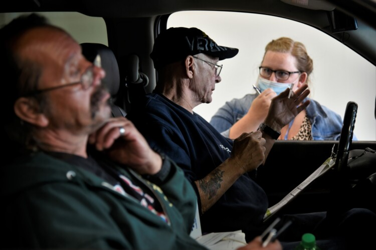 Workers get information about job openings at a drive-thru employment fair in Elkhart during the pandemic. (Justin Hicks/IPB News)