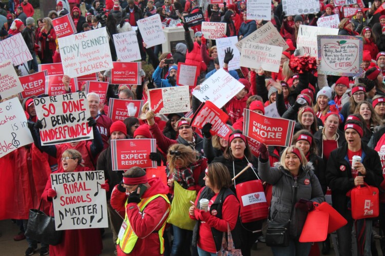 The Indiana State Teachers Association helped organize a massive educator and public school-focused rally at the Statehouse last year, to draw more attention to school funding and teacher compensation needs across the state. (Lauren Chapman/IPB News)