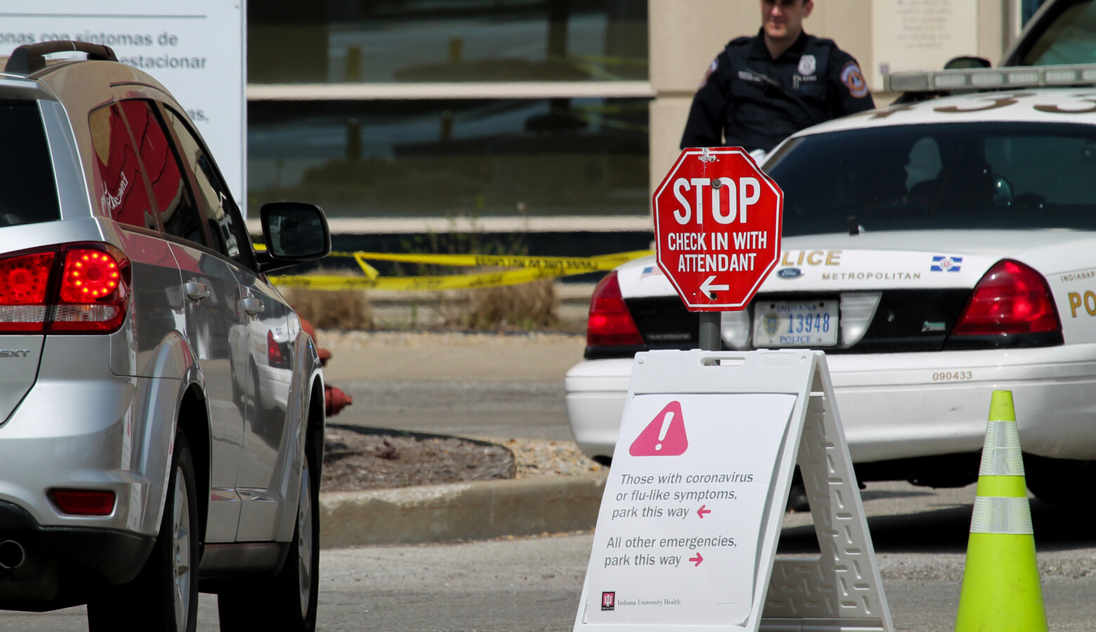 In front of Indiana University Health's Methodist Hospital, signs direct emergency room patients if they are experiencing COVID-19 symptoms. (Lauren Chapman/IPB News)