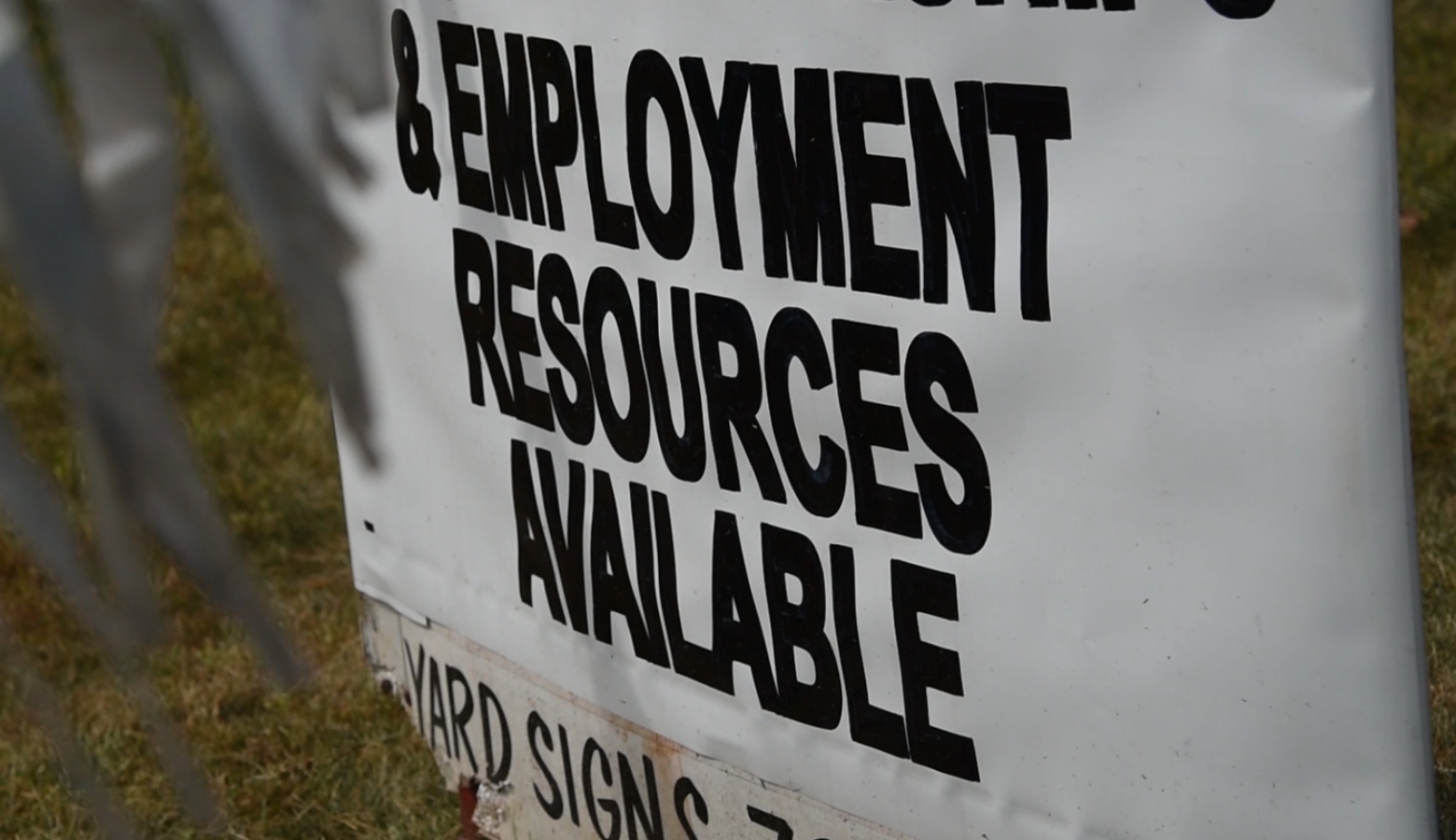 A sign outside Nu Corinthian Baptist Church in Indianapolis advertises employment resources at a weekly food handout during the pandemic. (Justin Hicks / IPB News)