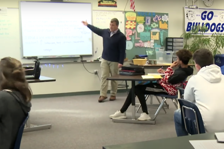 Keith Morey explains the concept of a theory at Centerville-Abington Junior High School. (FILE PHOTO: Tyler Lake/WTIU)