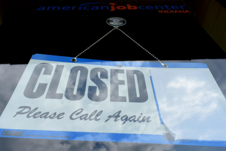 A WorkOne center in Knox, Indiana, displays a closed sign on the front door. (Justin Hicks/IPB News)