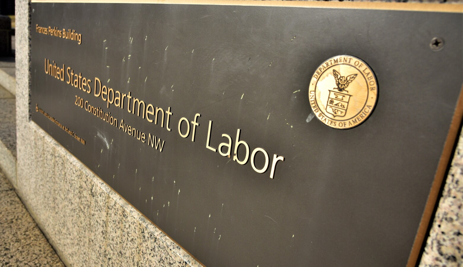A placard in front of the U.S. Department of Labor. (Justin Hicks/IPB News)