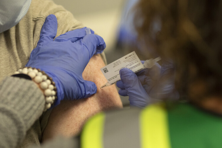 Some schools have been able to coordinate initial COVID-19 vaccines for their teachers, as local health officials work to roll out initial doses to health workers and long-term care residents across the state. (Provided by Indiana University Health)