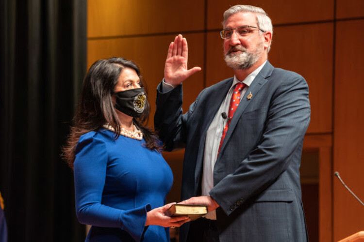 Gov. Eric Holcomb, alongside his wife Janet, is sworn in for his second term as Indiana governor. (Courtesy of the governor's office)