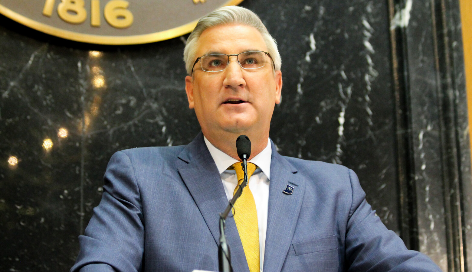 "Gov. Eric Holcomb said while COVID-19 numbers are improving, it's not time for a ""mission accomplished"" moment. (Lauren Chapman/IPB News)"