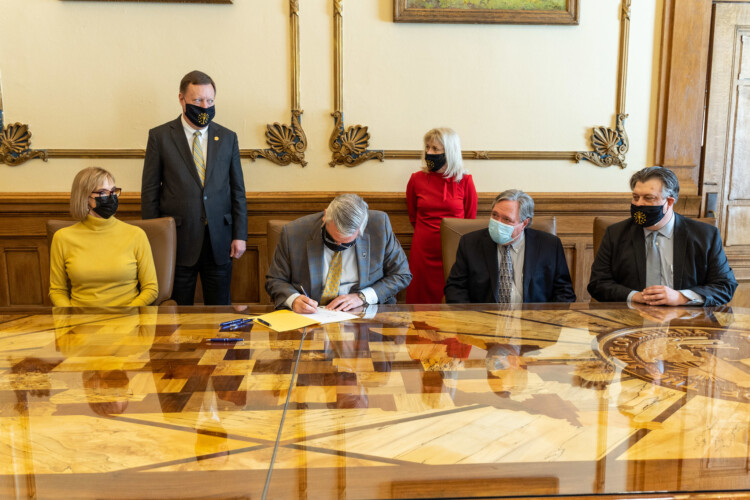 Gov. Eric Holcomb signed Senate Bill 1 into law Thursday. It will give businesses, schools, health care providers and others protections from COVID-19 civil lawsuits. (Governor Eric Holcomb/Flickr)