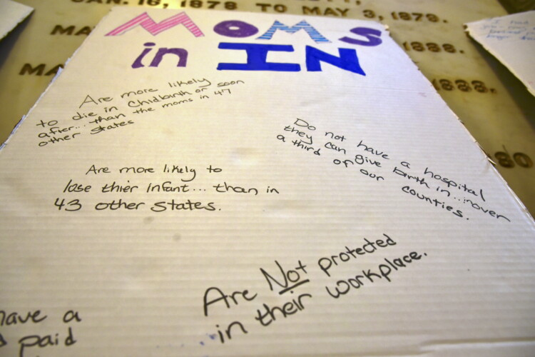 A poster advocating for better policies for women from a Hoosier Action statehouse rally during the 2021 legislative session. (Justin Hicks/IPB News)