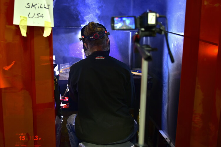 A student at the Elkhart Area Career Center welds a design for the SkillsUSA competition while being recorded on camera. (Justin Hicks/IPB News)