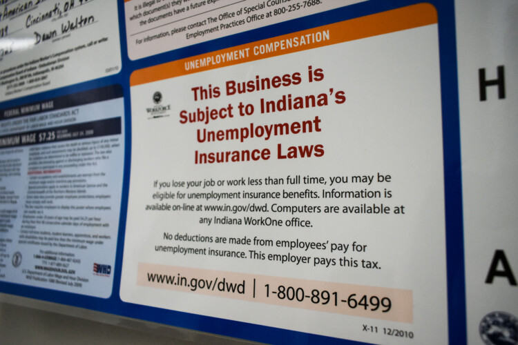 A public notice inside a human resources office stating it is subject to Indiana's unemployment insurance laws. (Justin Hicks/IPB News)