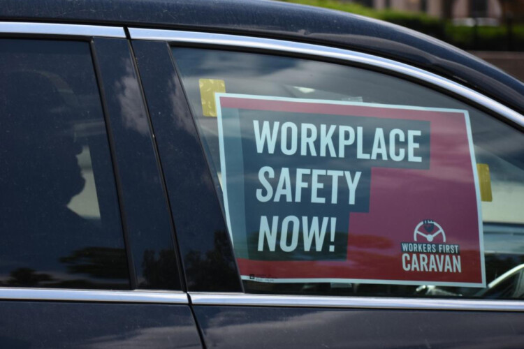 """A sign in a car caravan at a labor rally in 2019 reads """"Workplace Safety Now!"""" (Justin Hicks/IPB News)"""