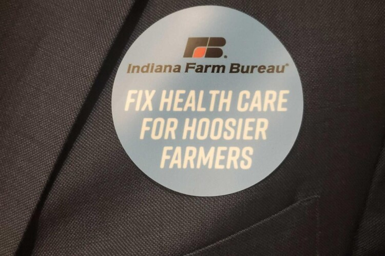 Indiana Farm Bureau members wore stickers during the 2020 Indiana legislative session to show support for a bill that would allow the organization to offer health benefit plan. (Samantha Horton/IPB News)
