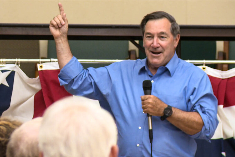 Former U.S. Sen. Joe Donnelly (D-Ind.) delivers a speech at a UAW hall in South Bend, promoting President Joe Biden's American Jobs Plan. (Justin Hicks/IPB News)