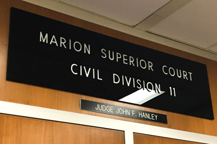 The plaque above a Marion County Superior Court where a hearing was held Wednesday regarding a possible injunction to keep federal unemployment benefits in Indiana. (Justin Hicks/IPB News)