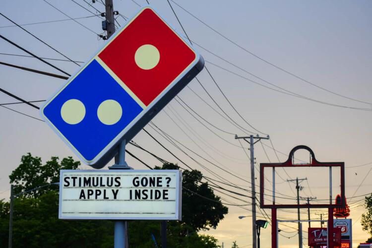 A Domino's Pizza in South Bend tells workers to apply if they're run out of pandemic stimulus money. (Justin Hicks/IPB News)