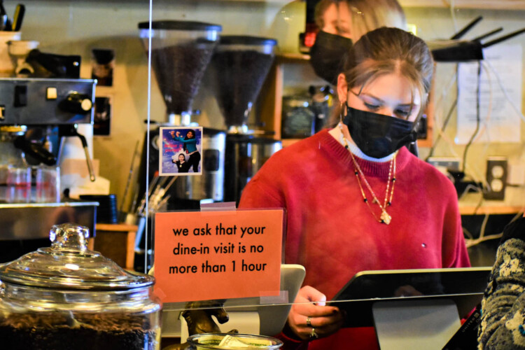 A young worker takes orders at the Blackbird Cafe in Valparaiso. (Justin Hicks/IPB News)